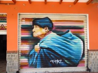 Otavalo graffiti of a typical Otavaleño woman