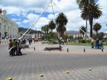 Locals taking down poles in Plaza Bolivar